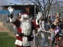 Santa Claus greets children at the Santa Fly-In