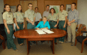 Joined by fellow staff, Susan Skalski, Forest Supervisor, Stanislaus National Forest signs the Record of Decision on the Rim Fire Recovery Project