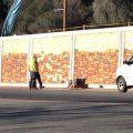 Painting retaining wall along Mono Way