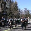 Led by the White Hackle Pipe Band, the Murphys Irish Day Parade makes its way down Main St.