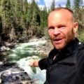 PBS series' Rob on the Road's Rob Stewart at Big Trees State Park pointing to the rushing waters of the Stanislaus River, spring 2017.