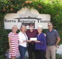 Board members Tracy Russell, Carey Haughy and Dana Mayo of Sonora Area Foundation flank retiring Sierra Repertory Theatre directors Dennis and Sara Jones as they receive the 2017 Irving J. Symons Community Impact Award