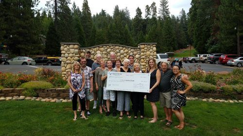 Heisinger family members and friends present a check for more than $12,000 to Adventist Health Sonora's Home Health and Hospice of the Sierra, proceeds from the annual Dick Heisinger Memorial Golf tournament.