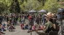 Park Ranger Kate performs music on the Earth Day Stage.