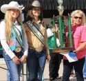 2018 Frog Jump Champion Laura-Kitchell, right hoists trophy next to Saddle Queens