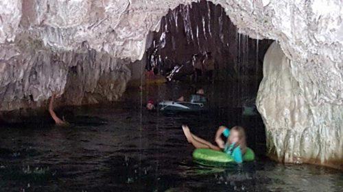Natural Bridges visitors swimming and floating